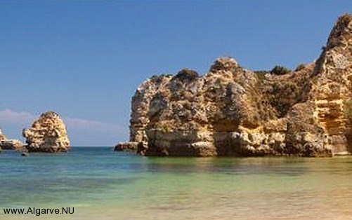 A rock formation with nice beach in the Algarve.