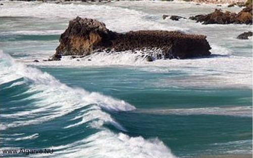 A picture of the waves and rocks in the Algarve, Portugal.